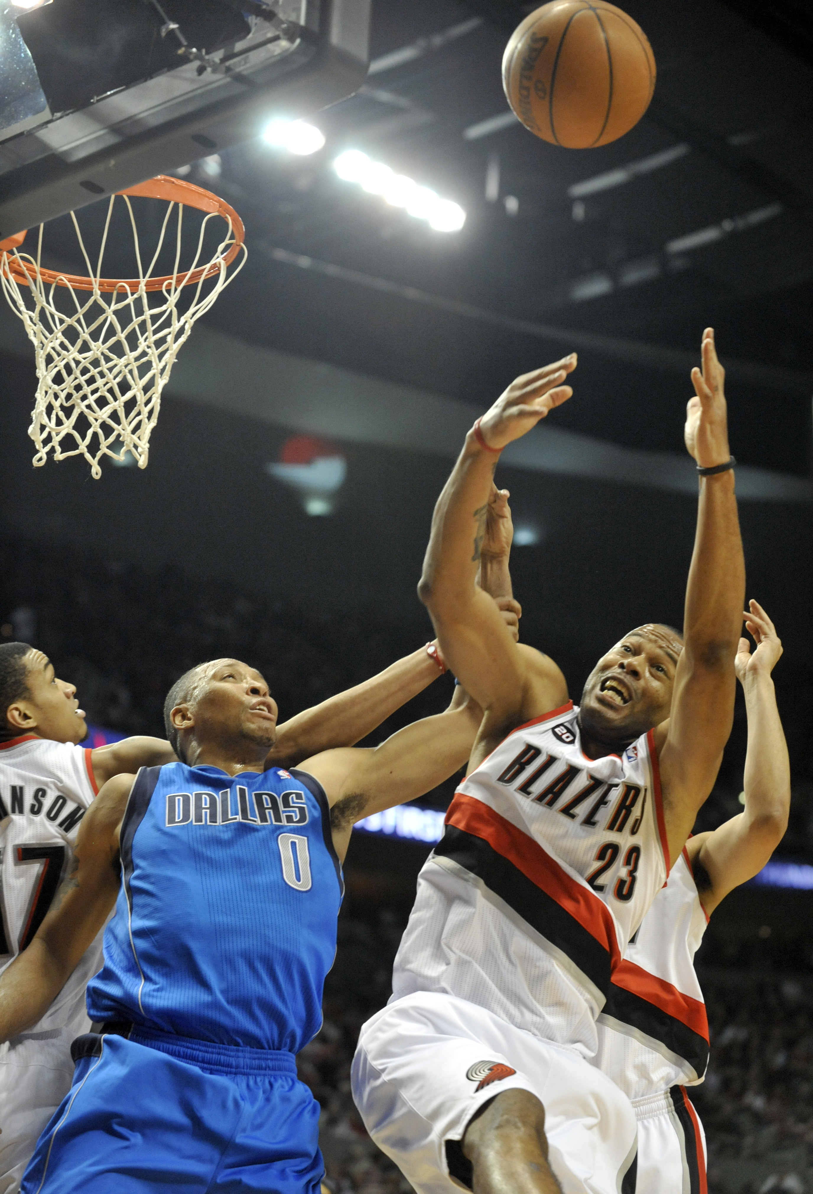 PORTLAND, OR - APRIL 28: Shawn Marion #0 of the Dallas Mavericks battles for a rebound with Marcus Camby #23 of the Portland Trail Blazers during the first quarter of Game Six of the Western Conference Quartefinals in the 2011 NBA Playsoffs on April 28, 2