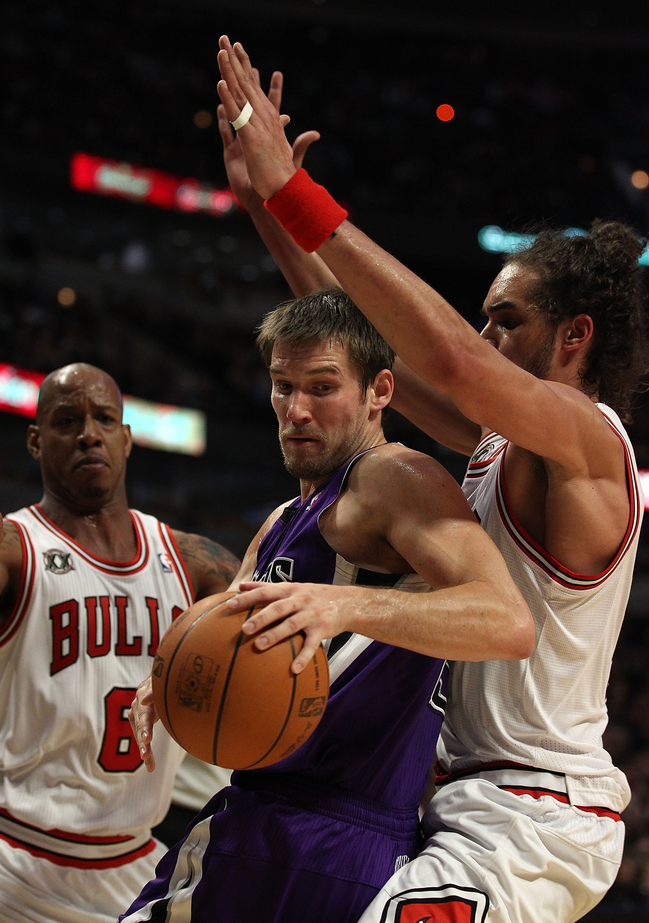 CHICAGO, IL - MARCH 21: Beno Udrih #19 of the Sacramento Kings tries to move under pressure from Joakim Noah #13 and Keith Bogans #6 of the Chicago Bulls at the United Center on March 21, 2011 in Chicago, Illinois. The Bulls defeated the Kings 132-92. NOT