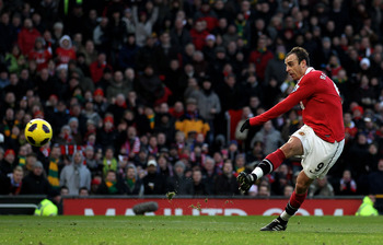 MANCHESTER, ENGLAND - NOVEMBER 27:  Dimitar Berbatov of Manchester United scores his team's third goal during the Barclays Premier League match between Manchester United and Blackburn Rovers at Old Trafford on November 27, 2010 in Manchester, England.  (P