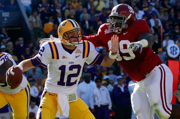 BATON ROUGE, LA - NOVEMBER 06:  Quarterback Jarrett Lee #12 of the Louisiana State University Tigers is sacked by Josh Chapman #99 of the Alabama Crimson Tide  at Tiger Stadium on November 6, 2010 in Baton Rouge, Louisiana.  (Photo by Chris Graythen/Getty