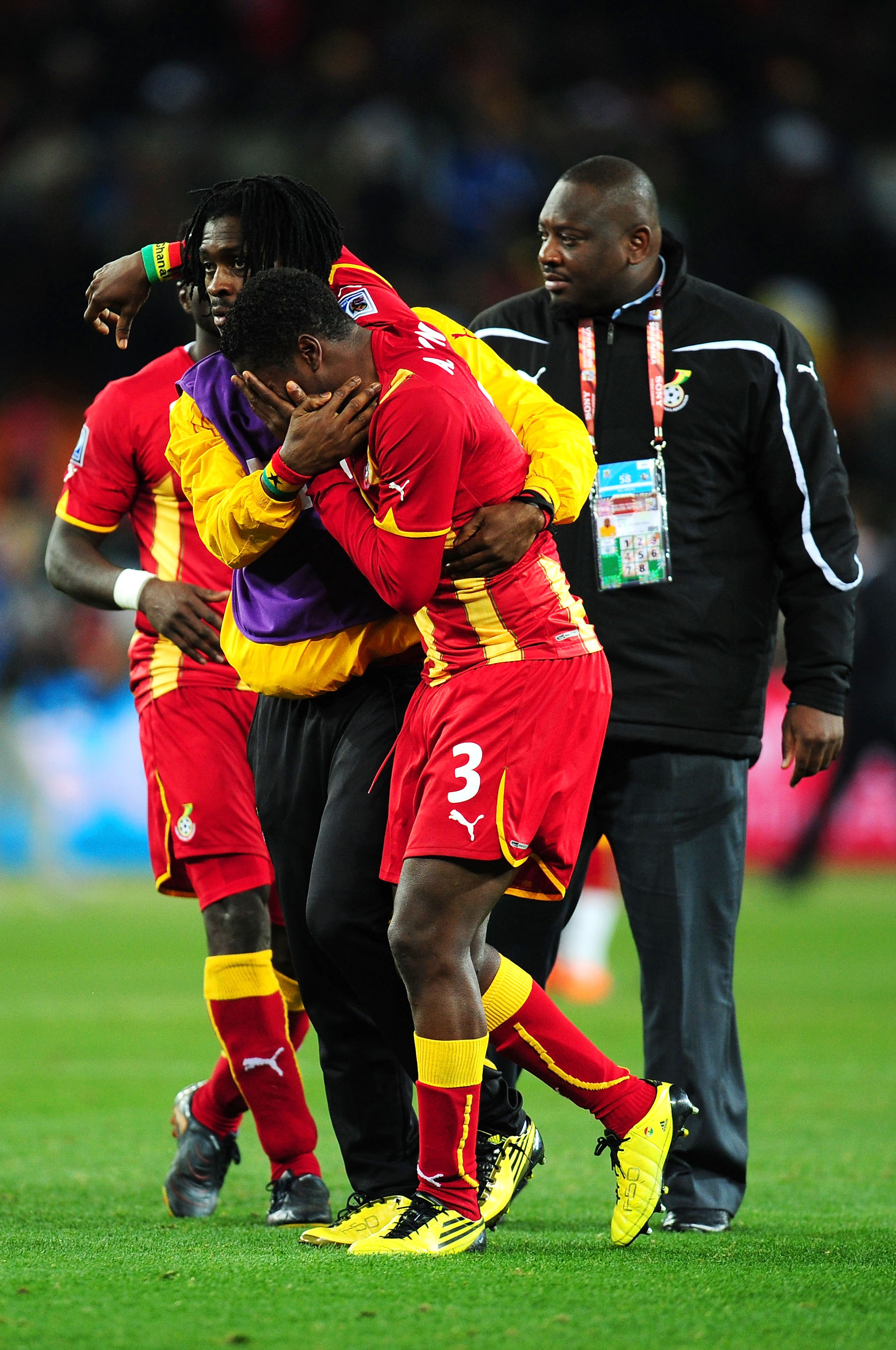 JOHANNESBURG, SOUTH AFRICA - JULY 02:  Asamoah Gyan of Ghana is consoled after his team are knocked out in a penalty shoot out during the 2010 FIFA World Cup South Africa Quarter Final match between Uruguay and Ghana at the Soccer City stadium on July 2,