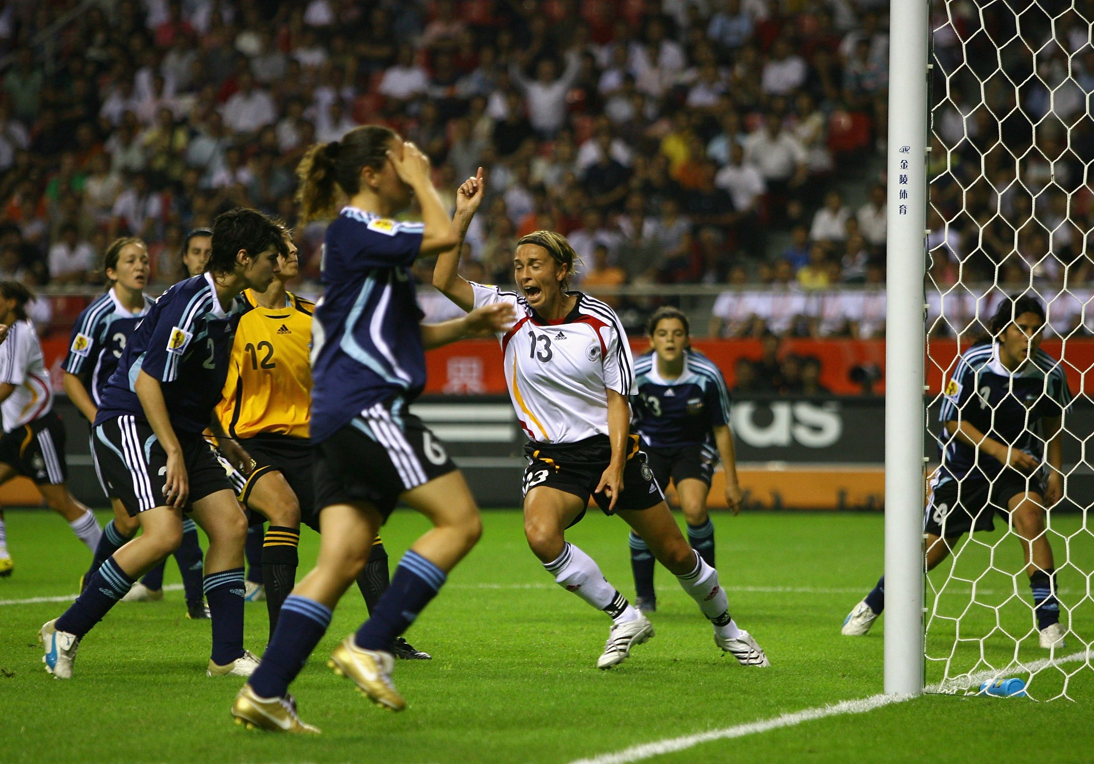 SHANGHAI, CHINA - SEPTEMBER 10:  Sandra Minnert of Germany celebrates after Vanina Correa of Argentina scored an own goal during the FIFA Women's World Cup 2007 Group A match between Germany and Argentina at the Shanghai Hongkou Football Stadium on Septem