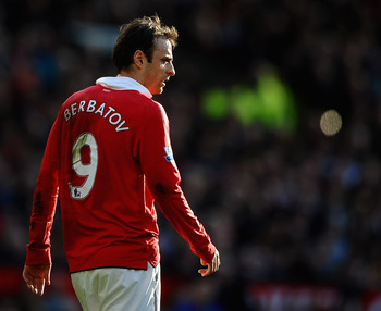 MANCHESTER, ENGLAND - MARCH 19: Dimatar Berbatov of Manchester United looks on during the Barclays Premier League match between Manchester United and Bolton Wanderers at Old Trafford on March 19, 2011 in Manchester, England.  (Photo by Laurence Griffiths/