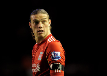 LIVERPOOL, ENGLAND - APRIL 11:  Andy Carroll of Liverpool looks on during the Barclays Premier League match between Liverpool and Manchester City at Anfield on April 11, 2011 in Liverpool, England.  (Photo by Michael Regan/Getty Images)