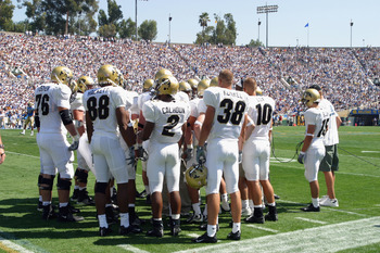 PASADENA, CA - SEPTEMBER 21:  The Colorado University Buffaloes offense huddles near the sideline before the play against the UCLA Bruins during the game on September 21, 2002 at the Rose Bowl in Pasadena, California.  Colorado defeated UCLA 31-17.  (Phot