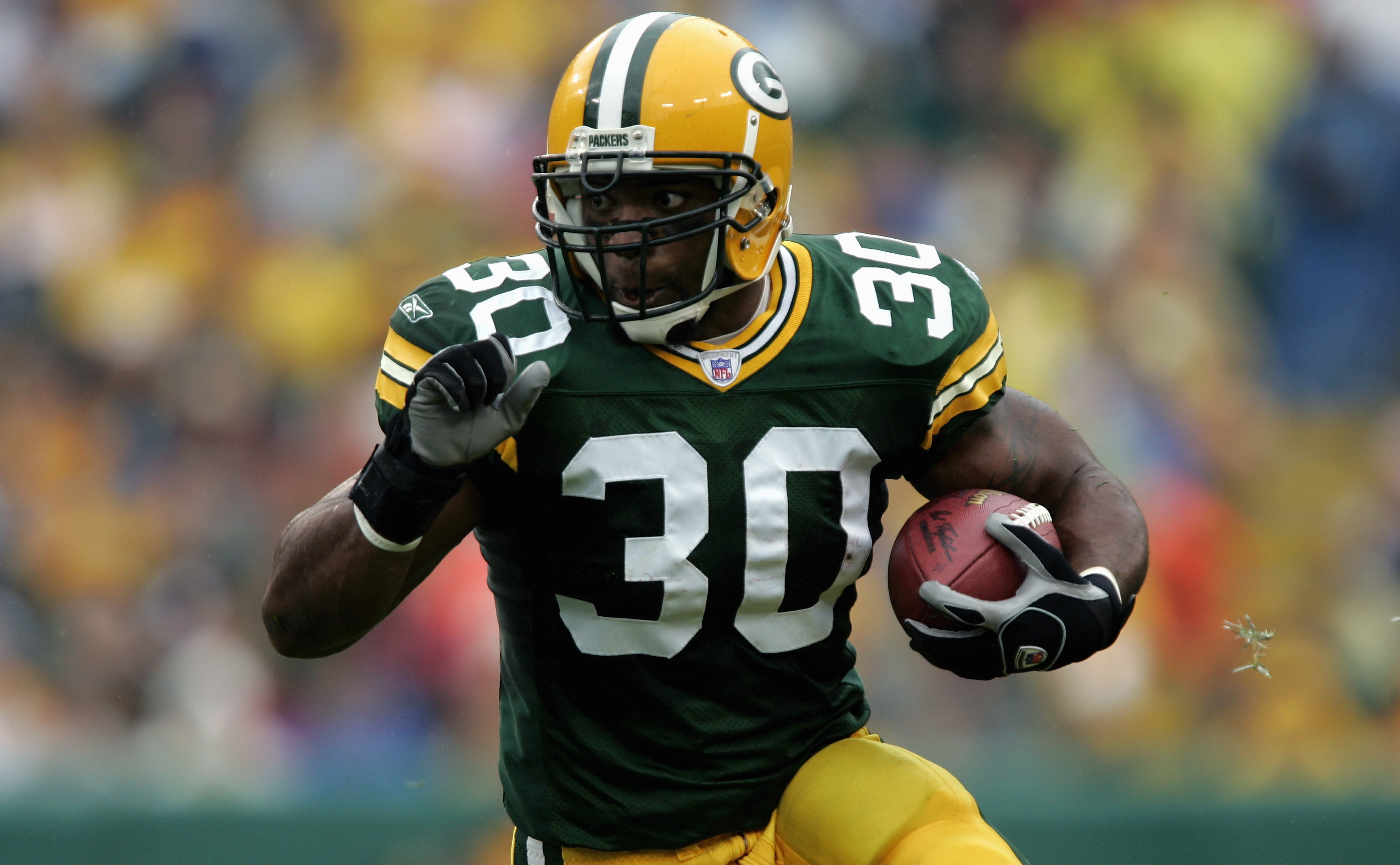 GREEN BAY, WI - SEPTEMBER 25:  Ahman Green #30 of the Green Bay Packers carries the ball during the game with the Tampa Bay Buccaneers on September 25, 2005 at Lambeau Field in Green Bay, Wisconsin.  The Bucs won 17-16.  (Photo by Brian Bahr/Getty Images)
