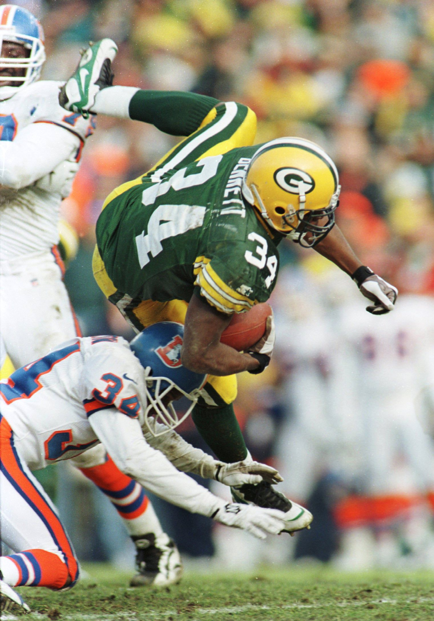 8 Dec 1996:  Running back Edgar Bennett #34  of the Green Bay Packers runs over Tyrone Braxton #34 of the Denver Broncos during the first half of their game  at Lambeau Field in Green Bay, Wisconsin. Mandatory Credit: Brian Bahr/Allsport