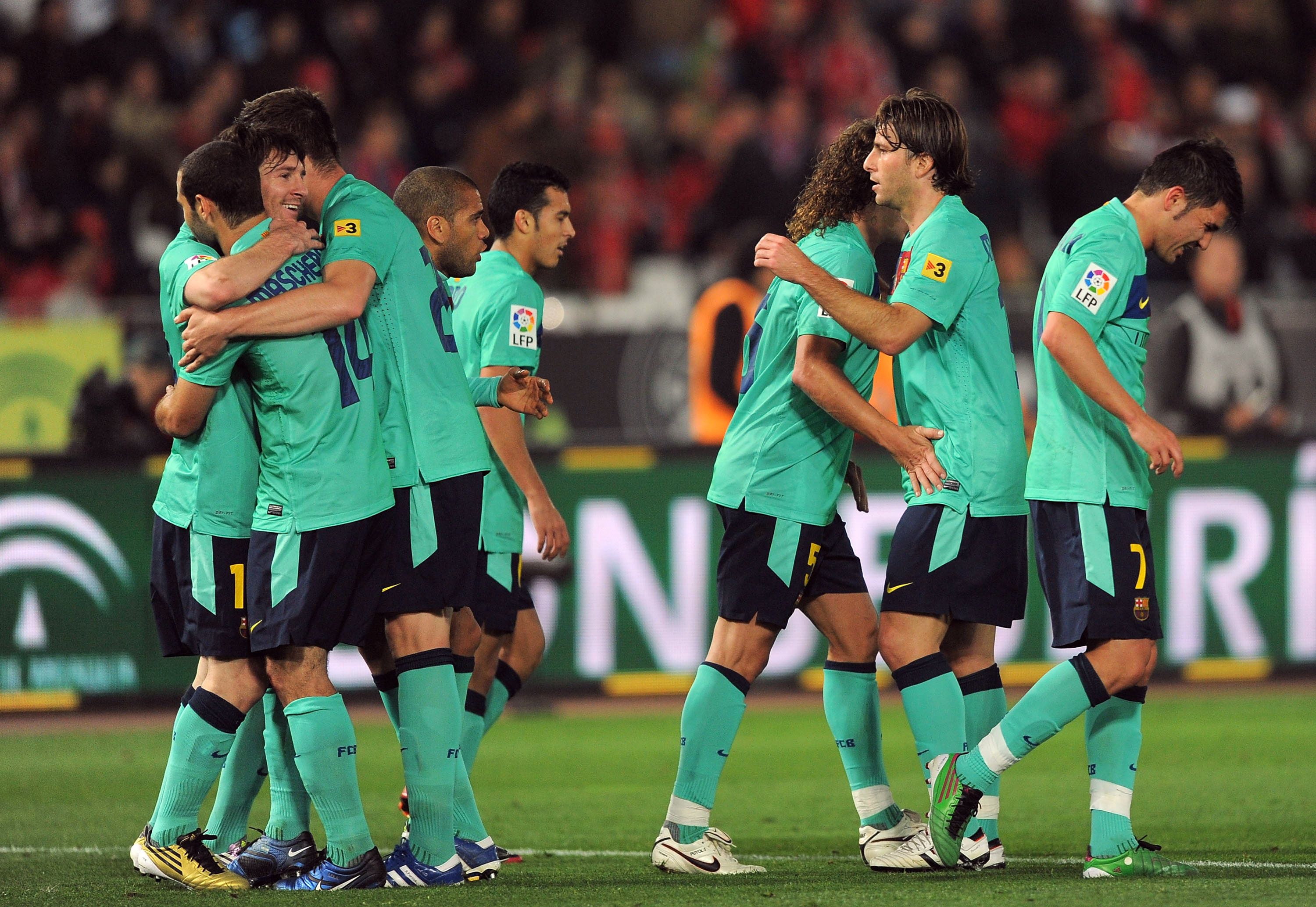 ALMERIA, SPAIN - NOVEMBER 20:  Barcelona players celebrate after scoring a goal during the La Liga match between UD Almeria and Barcelona at Estadio del Mediterraneo on November 20, 2010 in Almeria, Spain.  (Photo by Denis Doyle/Getty Images)