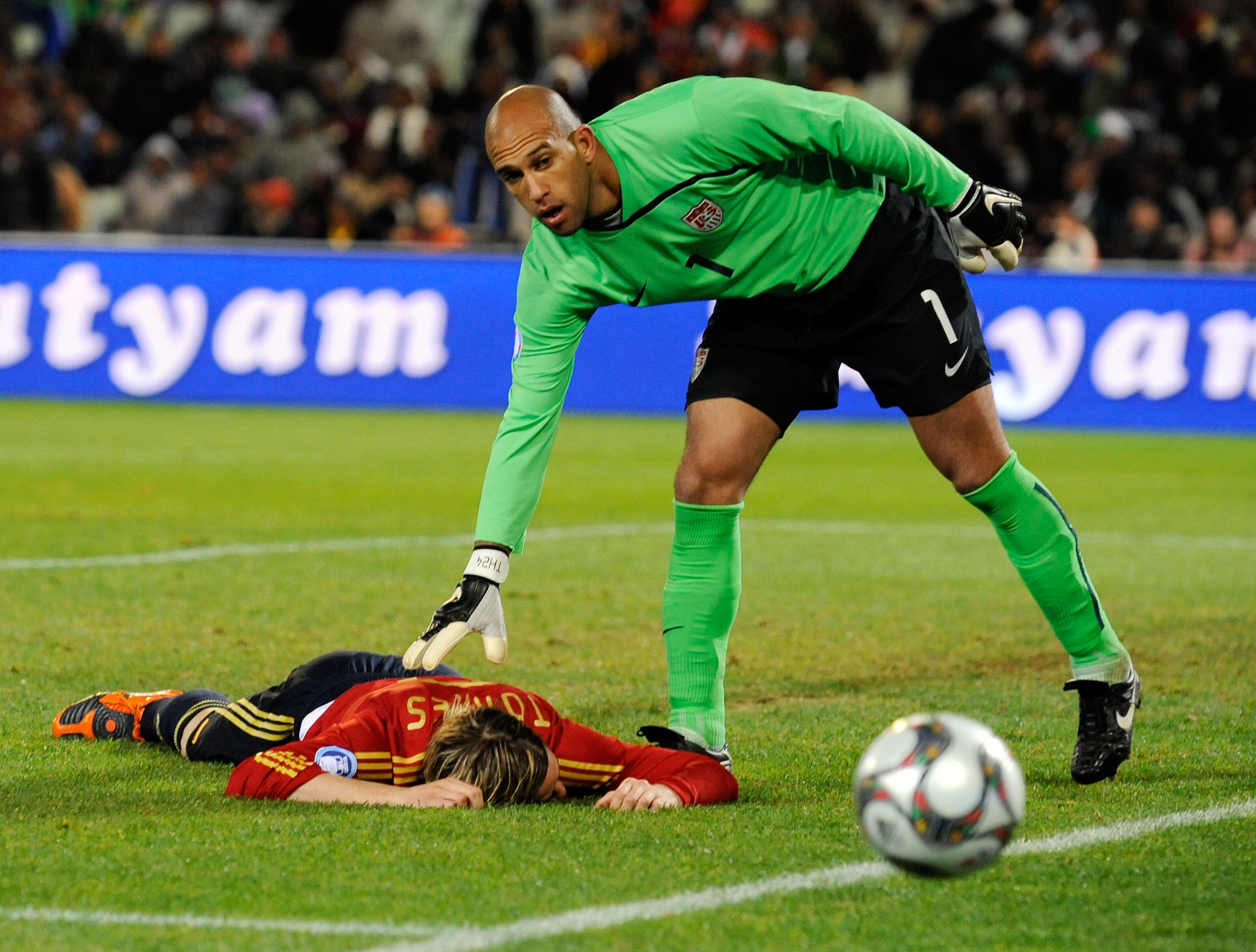 BLOEMFONTEIN, SOUTH AFRICA - JUNE 24:  Fernando Torres of Spain is consoled by goalie Tim Howard #1 of USA during the FIFA Confederations Cup Semi Final match between Spain and USA at the Free State Stadium on June 24, 2009 in Bloemfontein, South Africa.