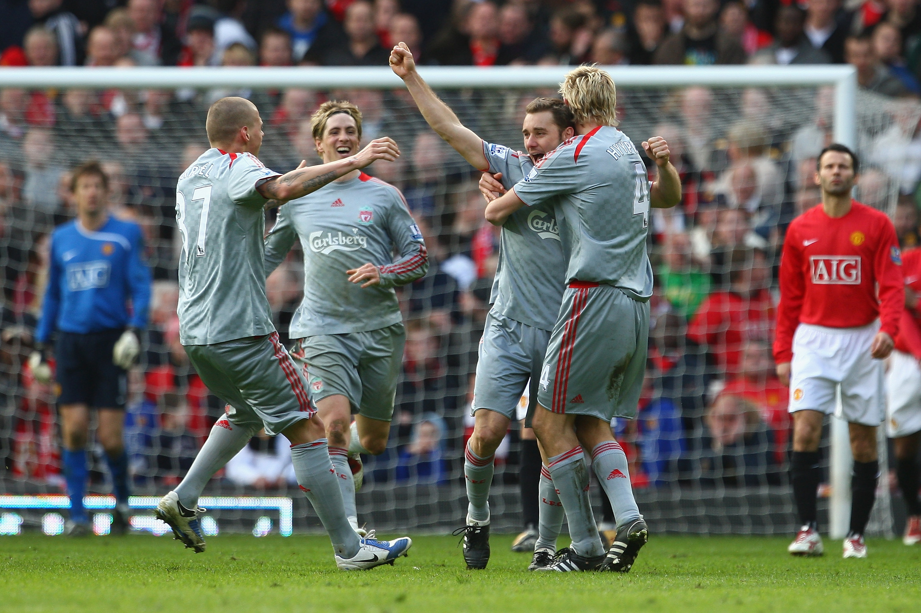 MANCHESTER, UNITED KINGDOM - MARCH 14:  Fabio Aurelio of Liverpool celebrates scoring his team's third goal with his team mates during the Barclays Premier League match between Manchester United and Liverpool at Old Trafford on March 14, 2009 in Mancheste