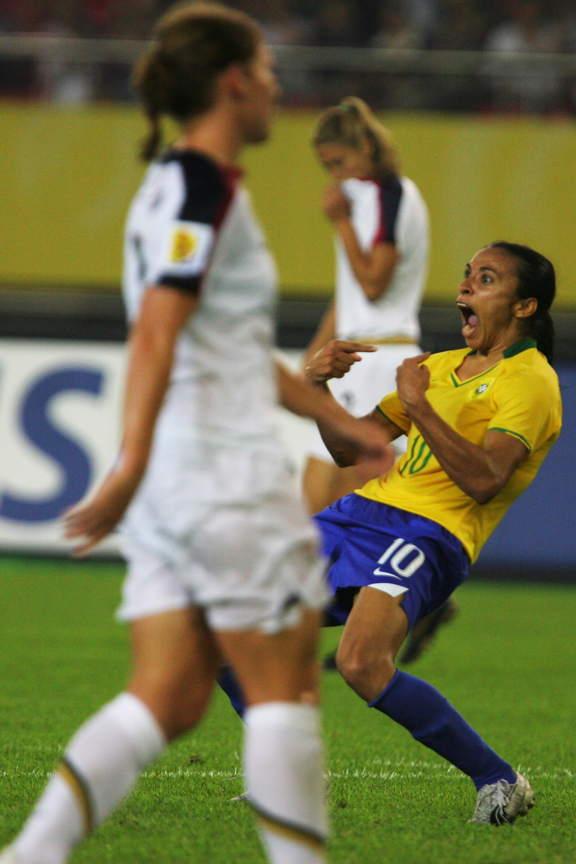 HANGZHOU, ZHEJIANG - SEPTEMBER 27:  Marta(R 10#)  of Brazil celebrates the goal  during the Womens World Cup 2007 Semi Final match between USA and Brazil at Hangzhou Dragon Stadium on September 27, 2007 in Hangzhou, Zhejiang province of China.  (Photo by