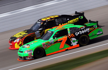 Danica races Steven Wallace at Las Vegas before finishing 4th.