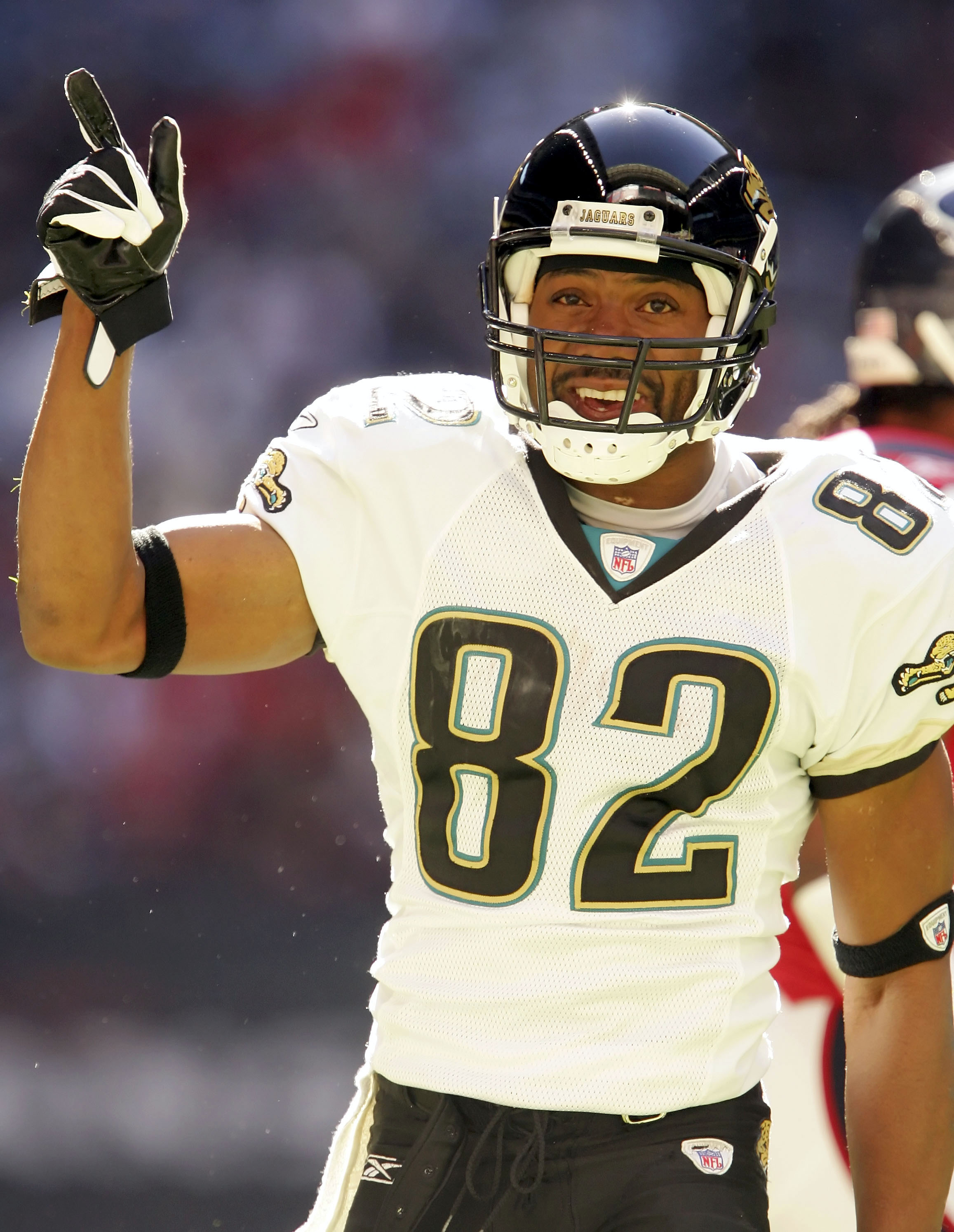 HOUSTON - DECEMBER 24:   Jimmy Smith #82 of the Jacksonville Jaguars celebrates during the game against the Houston Texans on December 24, 2005 at Reliant Stadium in Houston, Texas. The Jaguars won 38-20.  (Photo by Lisa Blumenfeld/Getty Images)