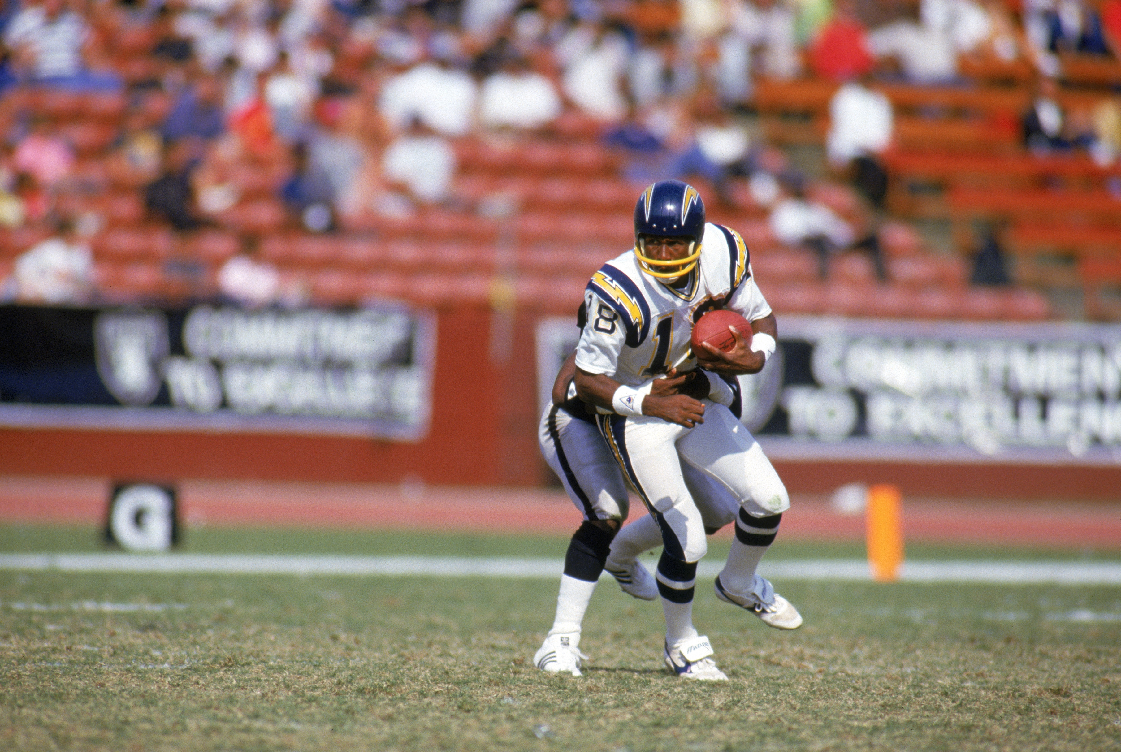 LOS ANGELES - 1985:  Wide receiver Charlie Joiner #18 of the San Diego Chargers tries to break away from a tackle during a game against the Los Angeles Raiders in 1985 at Los Angeles Memorial Coliseum in Los Angeles, California.  (Photo by Rick Stewart/Ge