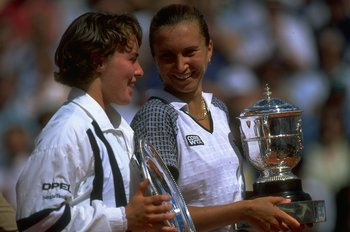 8 Jun 1997:  Martina Hingis (left) of Switzerland and Iva Majoli (right) of Croatia hold their respective trophies after the Women's Singles final during the French Open at Roland Garros in Paris. Majoli won the match in straight sets 6-4, 6-2. \ Mandator