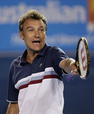 MELBOURNE, AUSTRALIA - JANUARY 29:  Mats Wilander of Sweden reacts after a point in his legends match against Pat Cash of Australia during day eleven of the 2009 Australian Open at Melbourne Park on January 29, 2009 in Melbourne, Australia.  (Photo by Luc