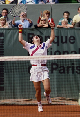 Arantxa Sanchez Vicario of Spain throws her racquet into the air after winning  the Women's Singles final match  against Steffi Graf 7-6, 3-6, 7-5 at the French Open Tennis Championship on 10th June 1989 at the Stade Roland Garros Stadium in Paris, France