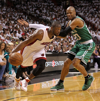 MIAMI, FL - MAY 01:  Dwyane Wade #3 of the Miami Heat drives around Ray Allen #20 of the Boston Celtics during Game One of the Eastern Conference Semifinals of the 2011 NBA Playoffs at American Airlines Arena on May 1, 2011 in Miami, Florida. NOTE TO USER