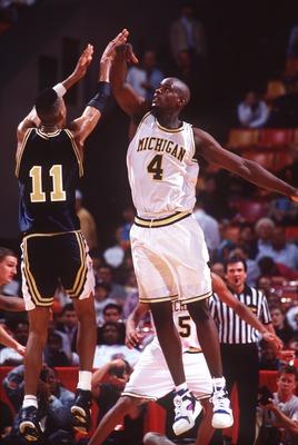1992:  MICHIGAN FORWARD CHRIS WEBBER ATTEMPTS TO BLOCK THE SHOT OF A GEORGIA TECH PLAYER IN AN NCAA BASKETBALL GAME. Mandatory Credit: Allsport/ALLSPORT