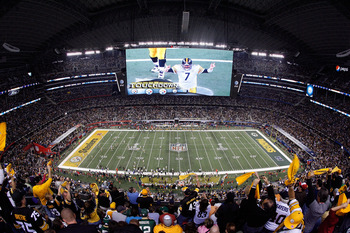 ARLINGTON, TX - FEBRUARY 06:  Quarterback Ben Roethlisberger #7 of the Pittsburgh Steelers is seen on the screen after the Steelers score a touchdown in the second half while taking on the Green Bay Packers during Super Bowl XLV at Cowboys Stadium on Febr