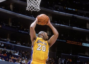21 Jan 2001:   Brian Shaw #20 of the Los Angeles Lakers rebounds the ball during the game against the Miami Heat at the STAPLES Center in Los Angeles, California. The Heat defeated the Lakers 103-92.   NOTE TO USER: It is expressly understood that the onl