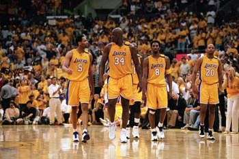 LOS ANGELES - JUNE 4:  Robert Horry #5, Shaquille O'Neal #34, Kobe Bryant #8 and Brian Shaw #20 of the Los Angeles Lakers walk on the court during Game 7 of the Western Conference Finals against the Portland Trail Blazers at Staples Center on June 4, 2000