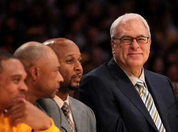 LOS ANGELES, CA - NOVEMBER 05:  Head coach Phil Jackson (L) of the Los Angeles Lakers smiles on the bench next to assistants Brian Shaw (C) and Jim Cleamons during the game with the Toronto Raptors at Staples Center on November 5, 2010 in Los Angeles, Cal
