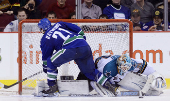 VANCOUVER, CANADA - JANUARY 20: Mason Raymond #21 of the Vancouver Canucks is stopped by goalie Antti Niemi #31 of the San Jose Sharks during the shootout in NHL action on January 20, 2011 at Rogers Arena in Vancouver, BC, Canada.  (Photo by Rich Lam/Gett
