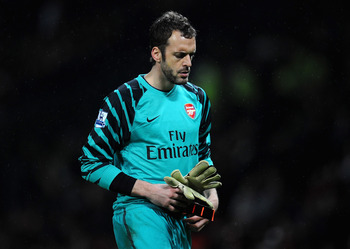 MANCHESTER, ENGLAND - MARCH 12:  Manuel Almunia of Arsenal looks dejected after defeat in the FA Cup sponsored by E.On Sixth Round match between Manchester United and Arsenal at Old Trafford on March 12, 2011 in Manchester, England.  (Photo by Clive Mason
