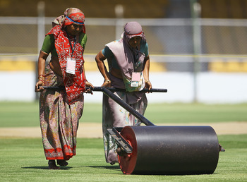 AHMEDABAD, INDIA - MARCH 22:  Women Groundstaff roll out the pitch during a India Nets Session at the Sardar Patel Gujarat Stadium on March 22, 2011 in Ahmedabad, India.  (Photo by Matthew Lewis/Getty Images)