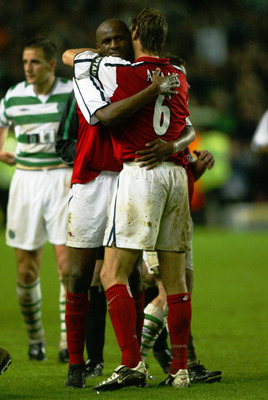LONDON - MAY 13:  Tony Adams and Patrick Vieira of Arsenal embrace each other during The Tony Adams Testimonial match between Arsenal and Celtic played at Highbury, in London on May 13, 2002. The match ended in a 1-1 draw. DIGITAL IMAGE. (Photo by Ben Rad
