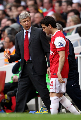 LONDON, ENGLAND - APRIL 02:  Arsenal manager Arsene Wenger talks to Cesc Fabregas of Arsenal as he prepares to go on during the Barclays Premier League match between Arsenal and Blackburn Rovers at the Emirates Stadium on April 2, 2011 in London, England.