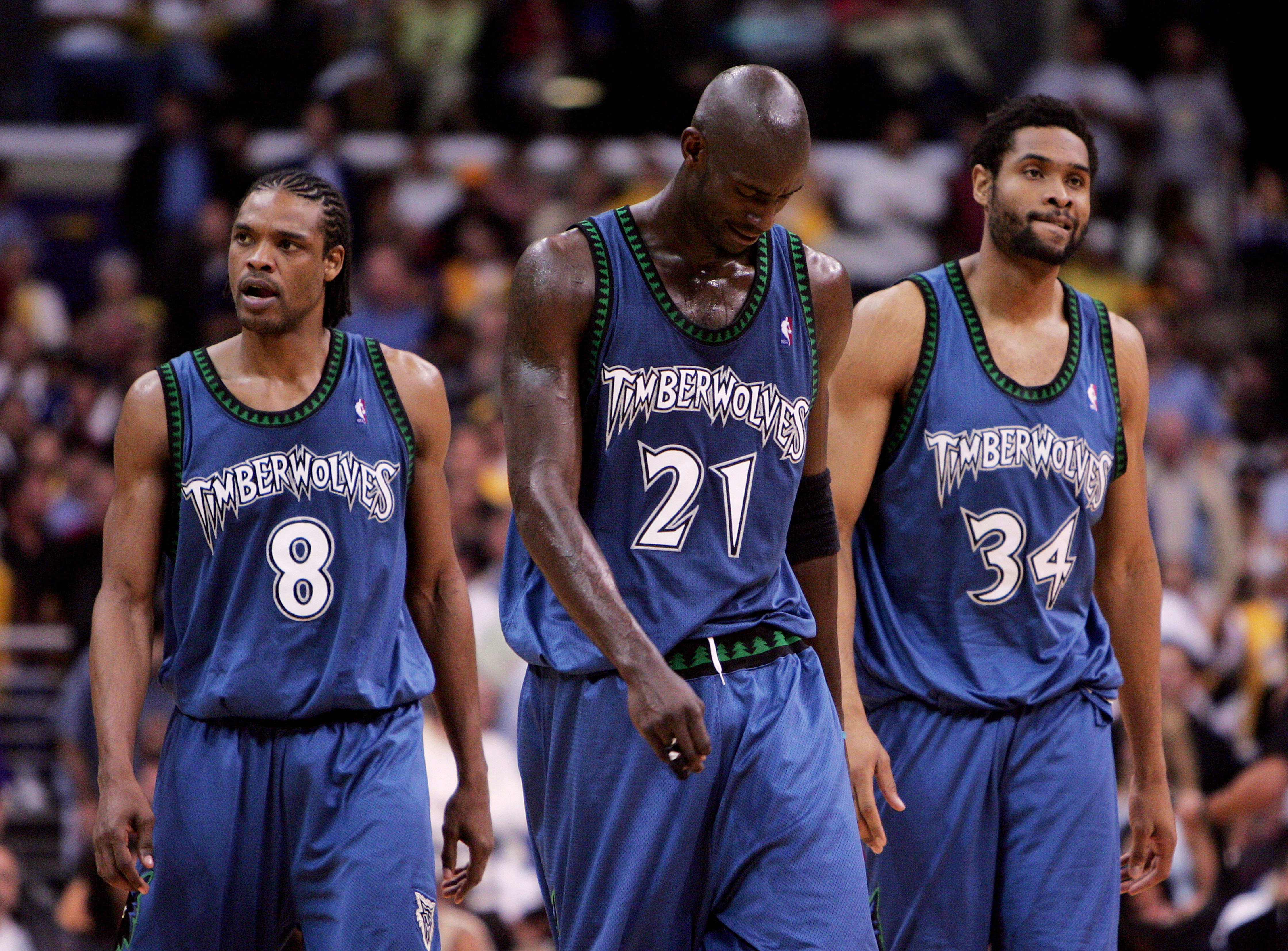 LOS ANGELES - MAY 25:  (L-R) Latrell Sprewell #8, Kevin Garnett #21 and Michael Olowokandi #34 of the Minnesota Timberwolves walk out onto the court after a time out against the Los Angeles Lakers in Game three of the Western Conference Finals during the