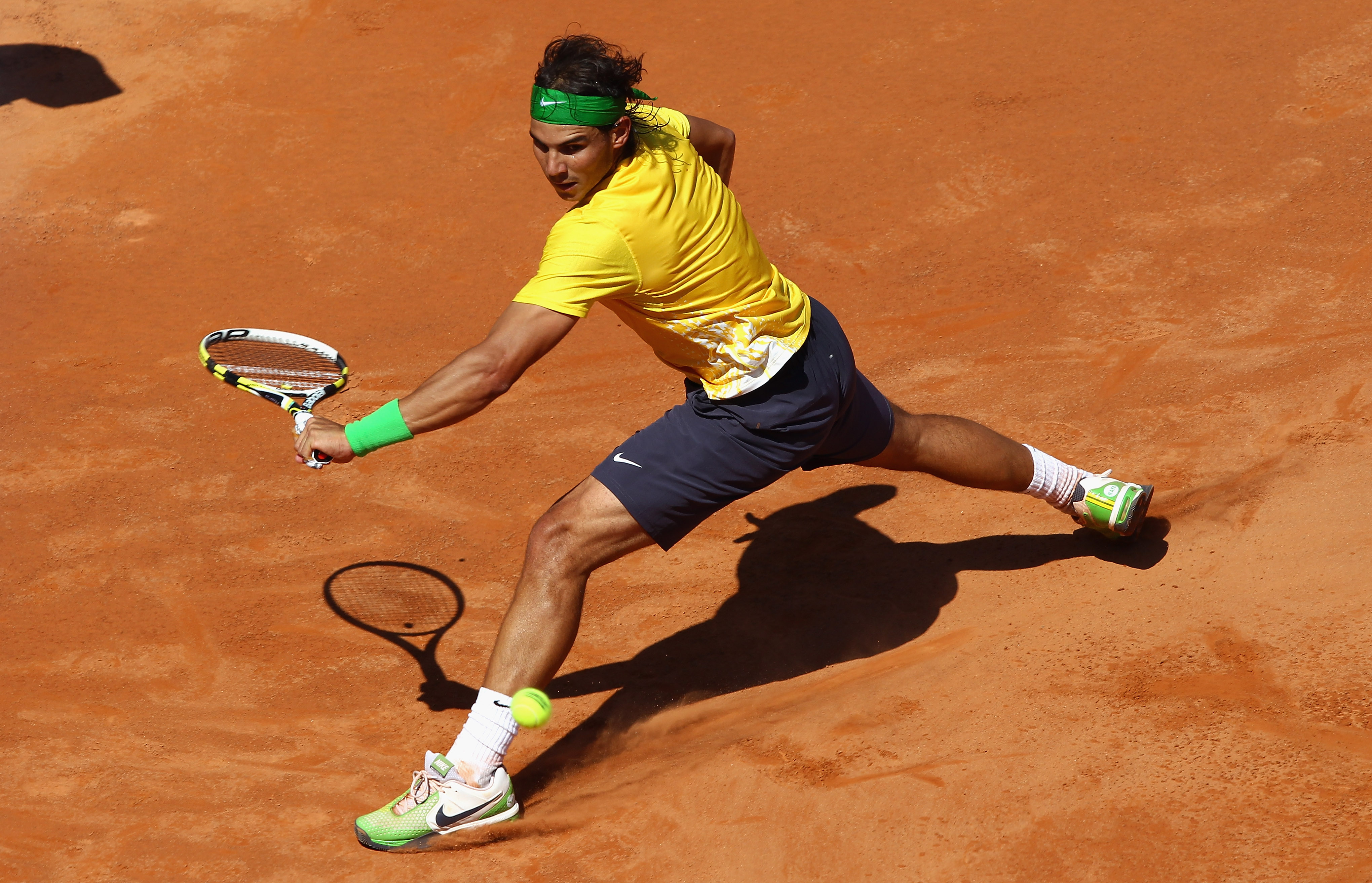 ROME, ITALY - MAY 13:  Rafael Nadal of Spain slides to play a backhand during his quarter final match against Marin Cilic of Croatia during day six of the Internazoinali BNL D'Italia at the Foro Italico Tennis Centre  on May 13, 2011 in Rome, Italy.  (Pho