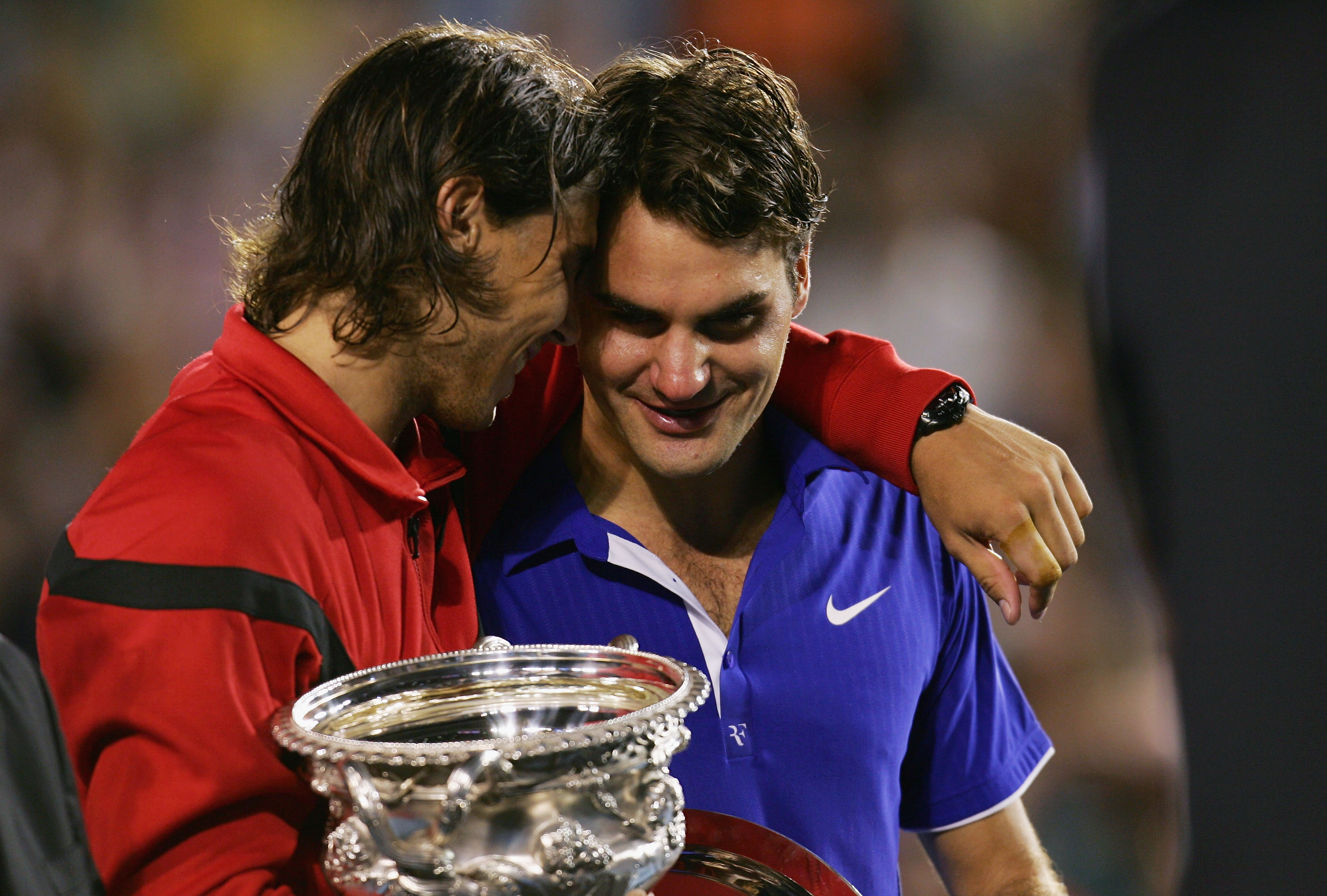 MELBOURNE, AUSTRALIA - FEBRUARY 01:  Rafael Nadal of Spain consoles Roger Federer of Switzerland during the trophy presentation after his men's final match during day fourteen of the 2009 Australian Open at Melbourne Park on  February 1, 2009 in Melbourne