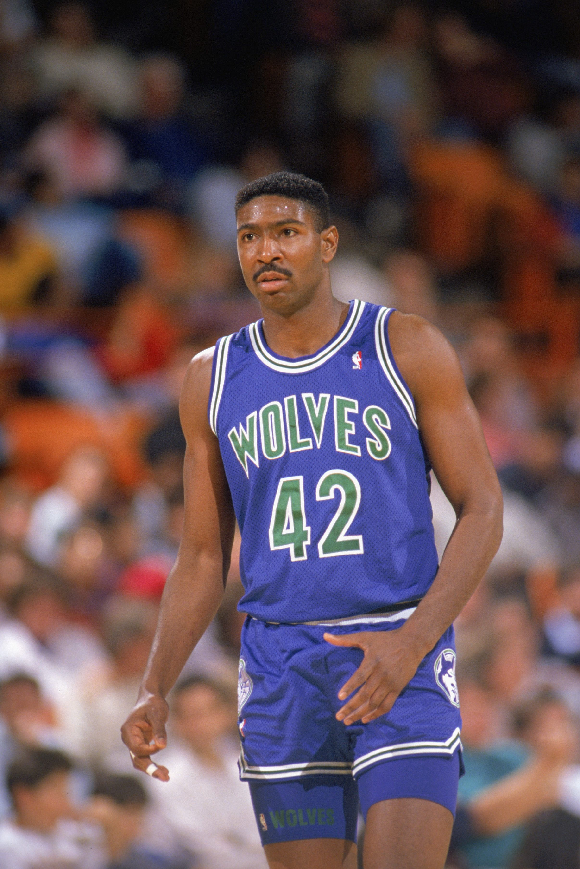 LOS ANGELES - 1990:  Sam Mitchell #42 of the Minnesota Timberwolves walks on the court during a game against the Los Angeles Lakers at the Great Western Forum in Los Angeles, California during the 1989-1990 NBA season.  (Photo by Ken Levine/Getty Images)