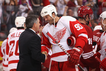 GLENDALE, AZ - APRIL 20:  Mike Modano #90 of the Detroit Red Wings shakes hands with head coach Dave Tippett of the Phoenix Coyotes following Game Four of the Western Conference Quarterfinals during the 2011 NHL Stanley Cup Playoffs at Jobing.com Arena on