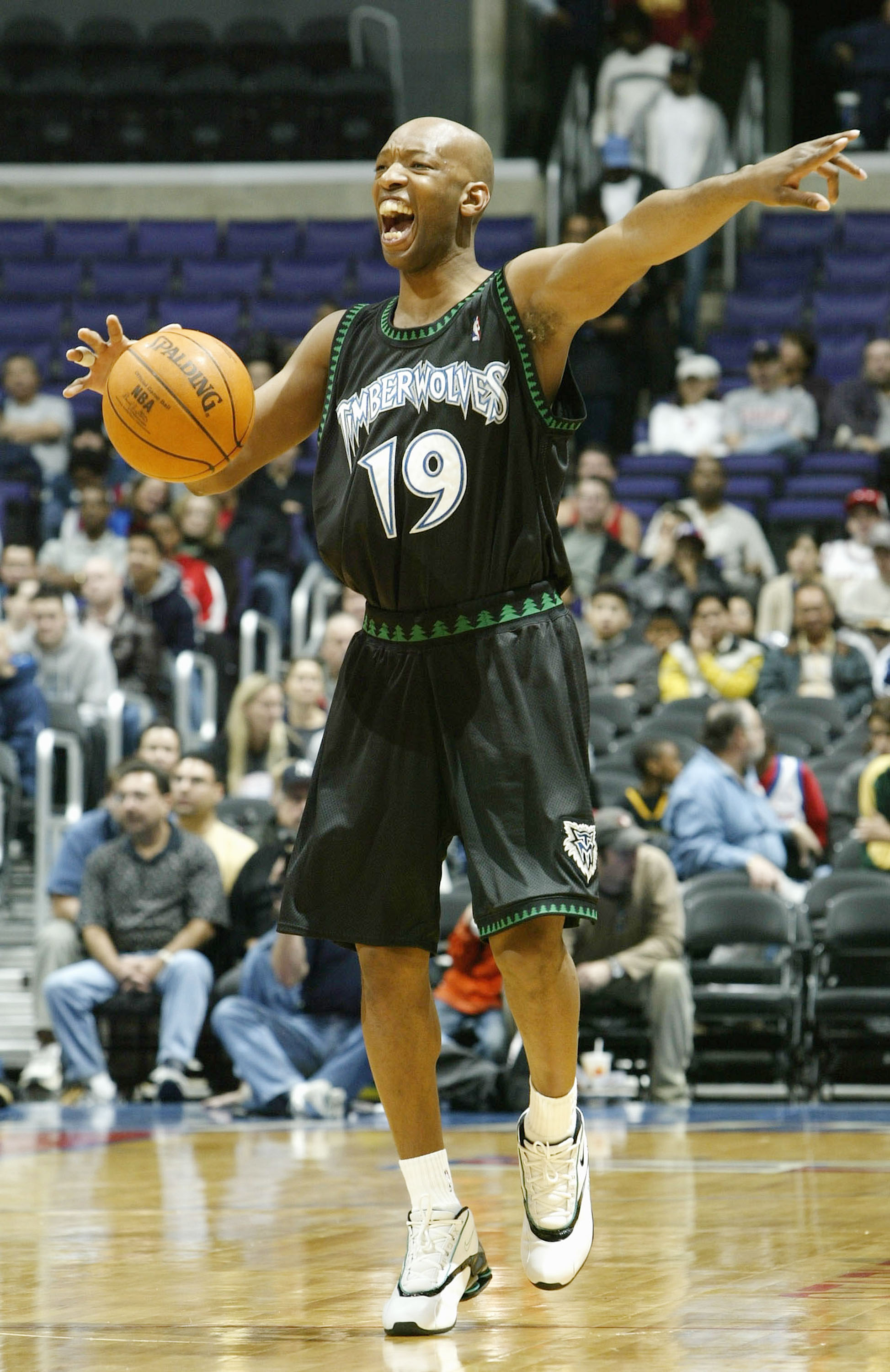 LOS ANGELES - DECEMBER 7:   Sam Cassell #19 of the Minnesota Timberwolves directs team against the Los Angeles Clippers on December 7, 2003 at Staples Center in Los Angeles, California. NOTE TO USER: User expressly acknowledges and agrees that, by downloa