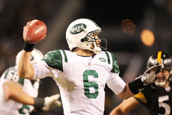 PITTSBURGH, PA - JANUARY 23:  Mark Sanchez #6 of the New York Jets drops back during their 19 to 24 loss to the Pittsburgh Steelers in the 2011 AFC Championship game at Heinz Field on January 23, 2011 in Pittsburgh, Pennsylvania.  (Photo by Ronald Martine