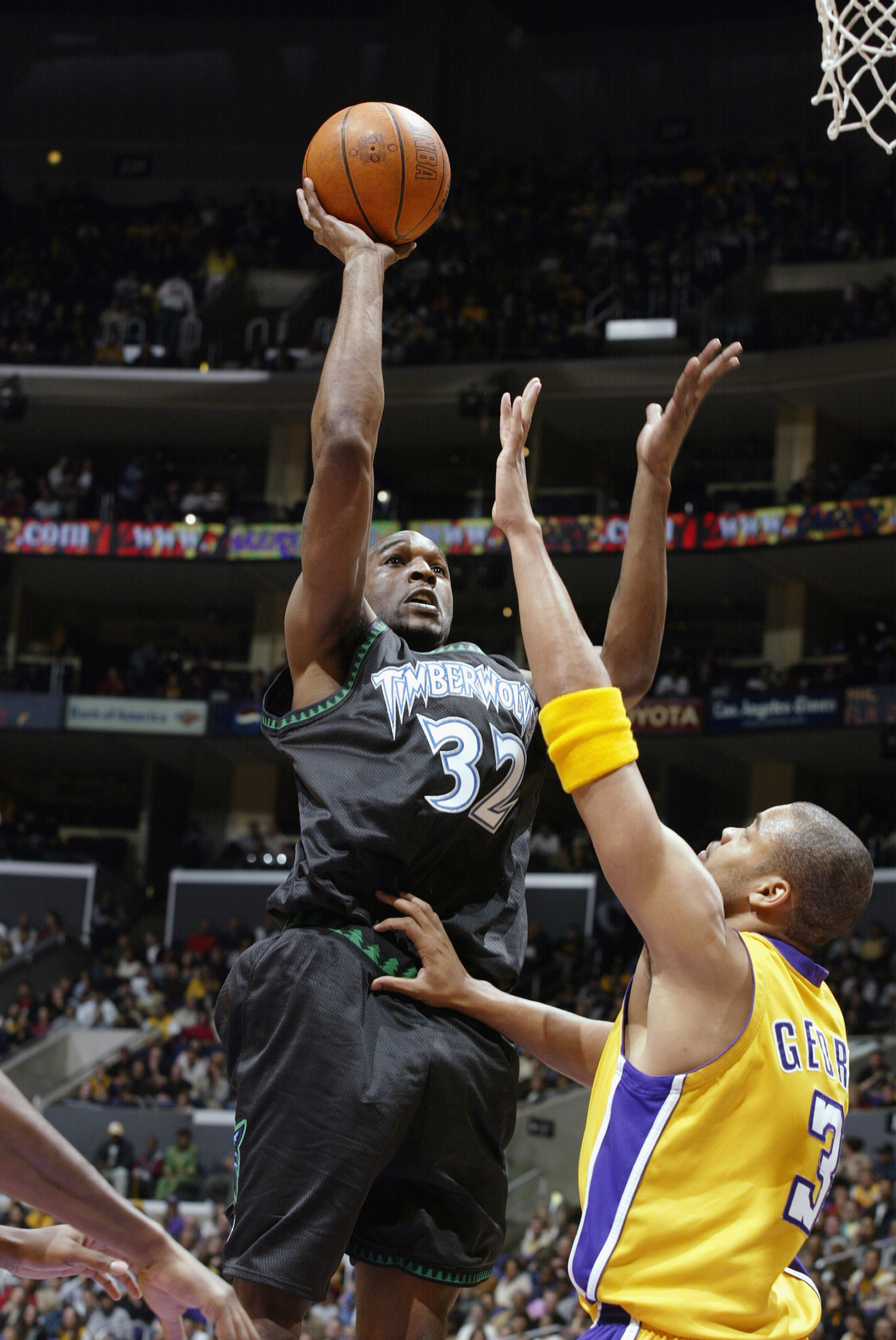 LOS ANGELES - MARCH 7:  Joe Smith #32 of the Minnesota Timberwolves puts a shot up over Devean George #3 of the Los Angeles Lakers during the NBA game at Staples Center on March 7, 2003 in Los Angeles, California.  The Lakers won 106-96.  NOTE TO USER: Us