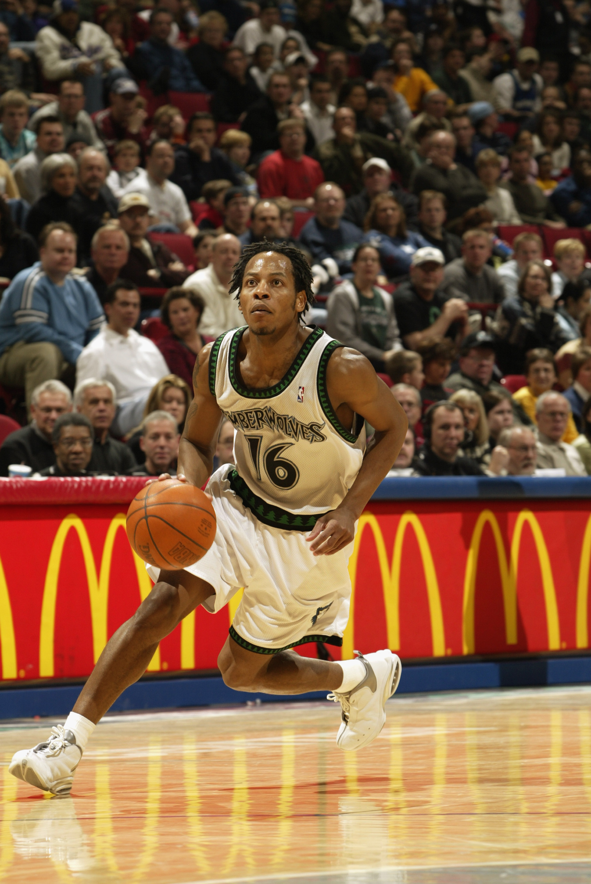MINNEAPOLIS - MARCH 2:  Troy Hudson #16 of the Minnesota Timberwolves dribbles against the New York Knicks during the game at Target Center on March 2, 2003 in Minneapolis, Minnesota.  The Timberwolves won 99-90.  NOTE TO USER: User expressly acknowledges