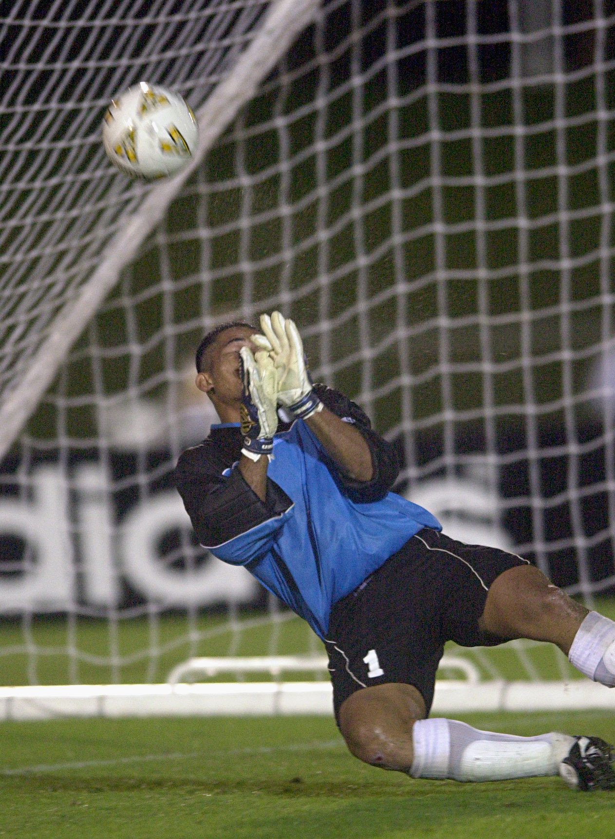 07 Apr 2001:  Nicky Salapu #1 of American Samoa dives in vain to stop a goal against Fiji during the Oceania group one World Cup qualifier match between Fiji and American Samoa played at the Coffs Harbour International Sports Stadium in Coffs Harbour, Aus