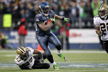 SEATTLE, WA - JANUARY 08:  Marshawn Lynch #24 of the Seattle Seahawks runs down field against Jabari Greer #33 of the New Orleans Saints during the 2011 NFC wild-card playoff game at Qwest Field on January 8, 2011 in Seattle, Washington.  (Photo by Otto G