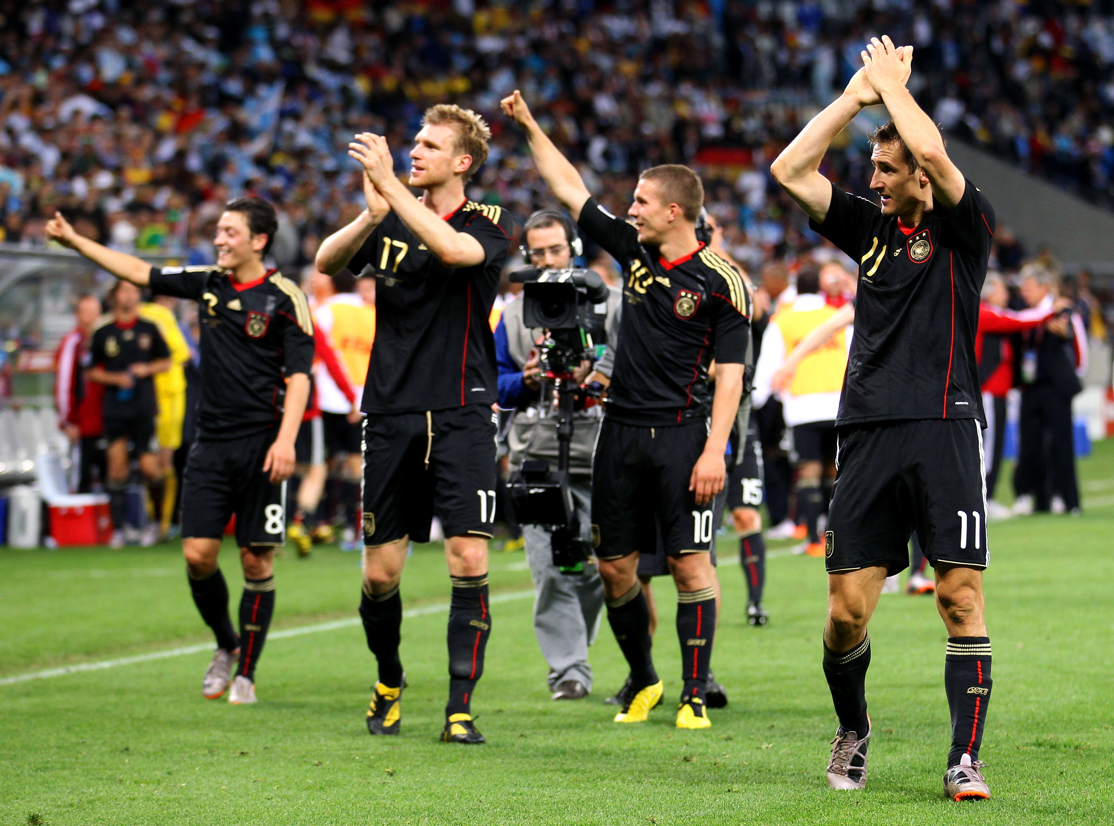 CAPE TOWN, SOUTH AFRICA - JULY 03:  Miroslav Klose (R) of Germany celebrates victory with team mates during the 2010 FIFA World Cup South Africa Quarter Final match between Argentina and Germany at Green Point Stadium on July 3, 2010 in Cape Town, South A