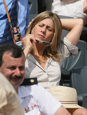 PARIS - JUNE 11:  Actress Jennifer Aniston attends the men's singles final between Roger Federer of Switzerland and Rafael Nadal of Spain during the French Open at Roland Garros on June 11, 2006 in Paris, France.  (Photo by Clive Brunskill/Getty Images)