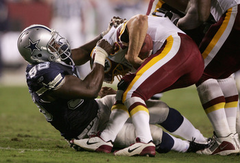LANDOVER, MD - SEPTEMBER 27: La'Roi Glover #97 of the Dallas Cowboys sacks quarterback Mark Brunell #8 of the Washington Redskins during the second quarter of play during the third week of the NFL season at FedEx Field September 27, 2004 in Landover, Mary