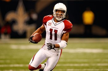 NEW ORLEANS - JANUARY 16:  Larry Fitzgerald #11 of the Arizona Cardinals runs for yards after the catch against the New Orleans Saints during the NFC Divisional Playoff Game at Louisana Superdome on January 16, 2010 in New Orleans, Louisiana. The Saints w