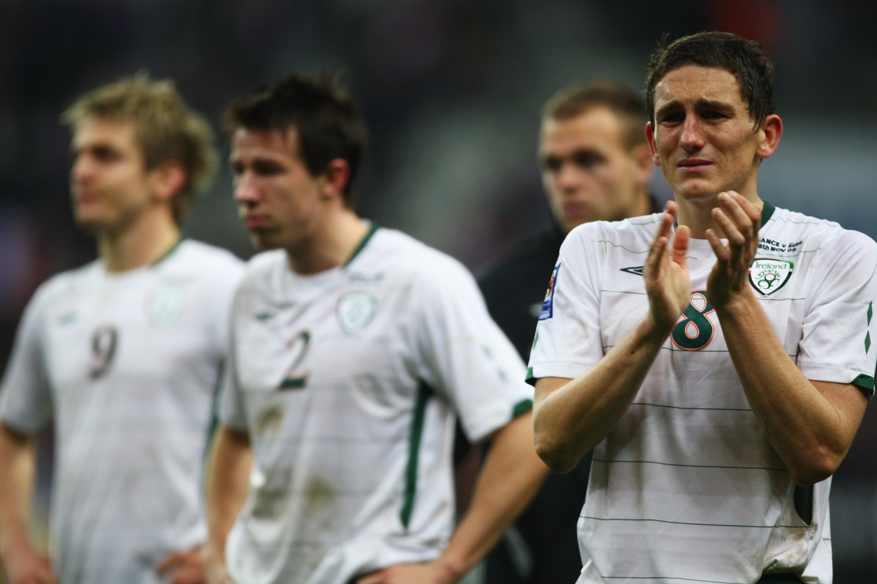 PARIS - FRANCE-NOVEMBER 18:  Keith Andrews (R) of Ireland applauds fans as Sean St. Ledger (C) and Kevin Doyle (L) look on after the FIFA 2010 World Cup Qualifying Play Off second leg match between France and Republic of Ireland at the Stade de France on