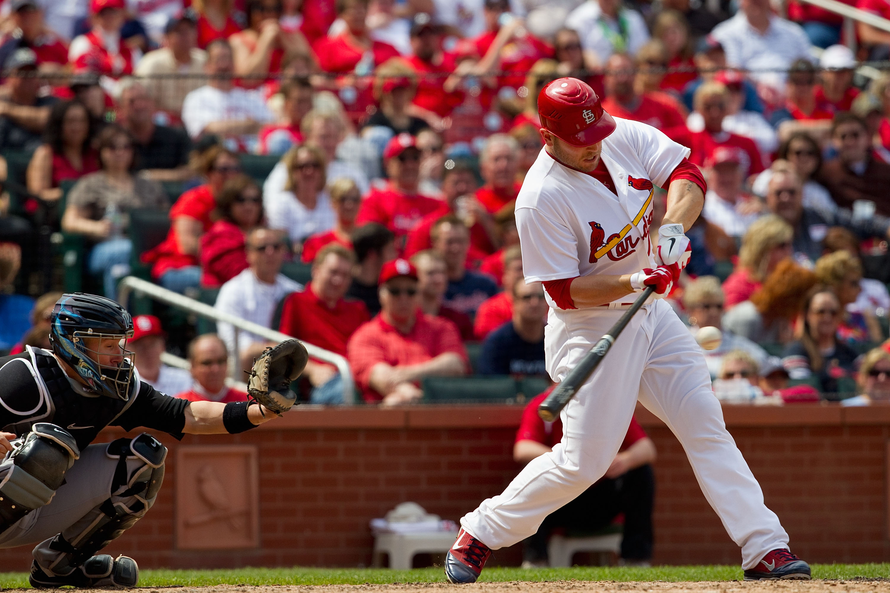 ST. LOUIS, MO - MAY 5: Matt Holliday #7 of the St. Louis Cardinals hits a game-tying RBI single against the Florida Marlins at Busch Stadium on May 5, 2011 in St. Louis, Missouri.  (Photo by Dilip Vishwanat/Getty Images)