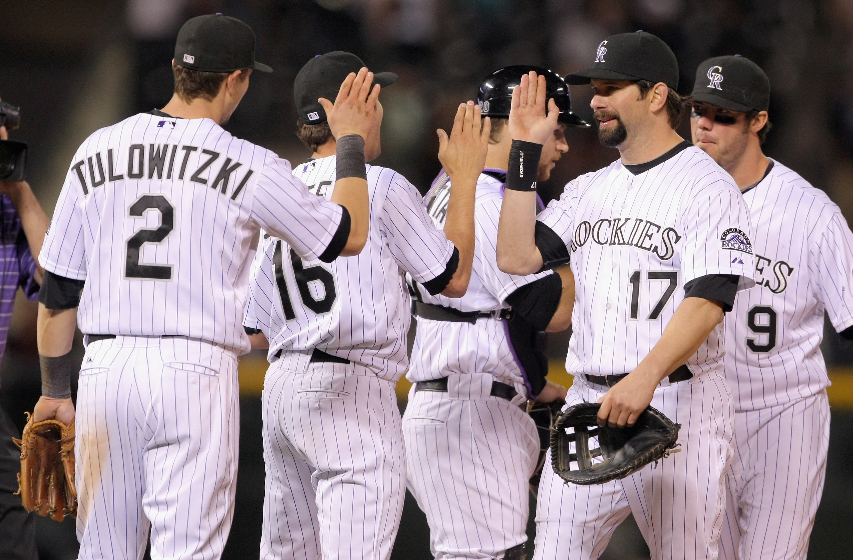 DENVER, CO - MAY 09:  Troy Tulowitzki #2, Huston Street #16, Chris Iannetta #20, Todd Helton #17 and Ian Stewart #9 of the Colorado Rockies celebrate after defeating the New York Mets 2-1 at Coors Field on May 9, 2011 in Denver, Colorado.  (Photo by Doug